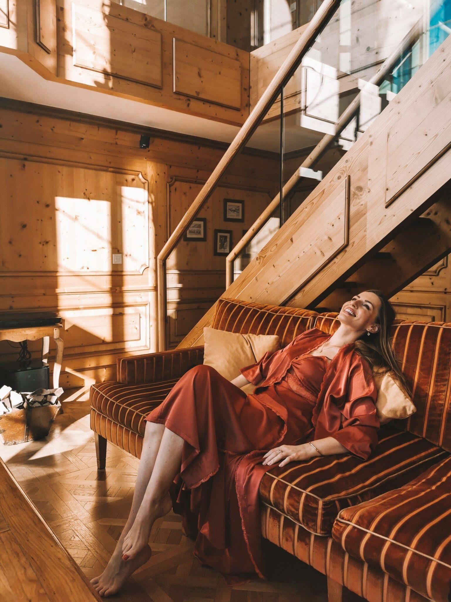 Izabela Switon-Kulinska in Mont Cervin Palace Duplex room wearing Three Floor dress