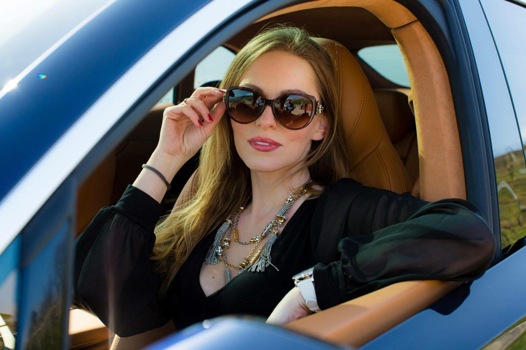 Izabela Switon-Kulinska @bella_zofia is sitting in Aston Martin DBX car in Geneva.