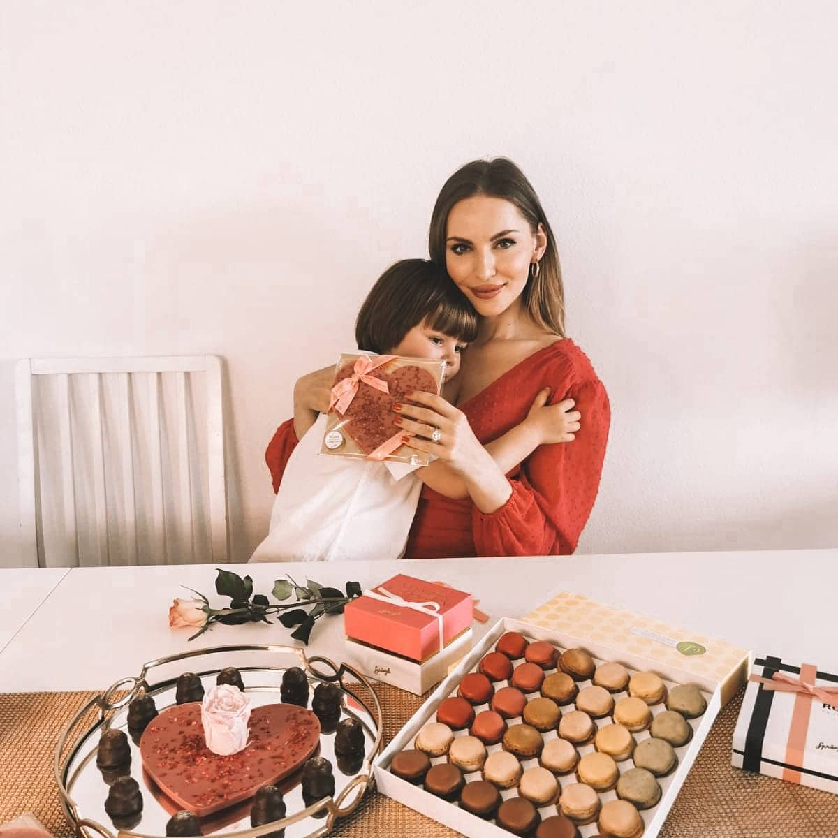 Confiserie Sprüngli chocolates for Mother's Day. Swiss Chocolate and macaroons. Izabela Switon-Kulinska with a son.